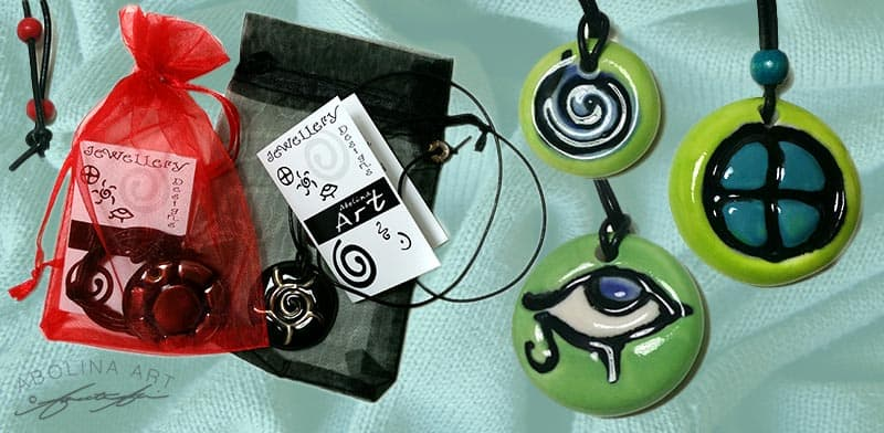 Wearable art handcrafted jewellery with positive symbols
